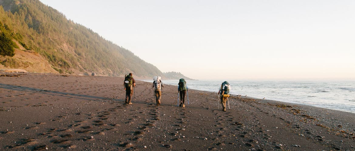 Four people hiking the northern section of the Lost Coast Trail
