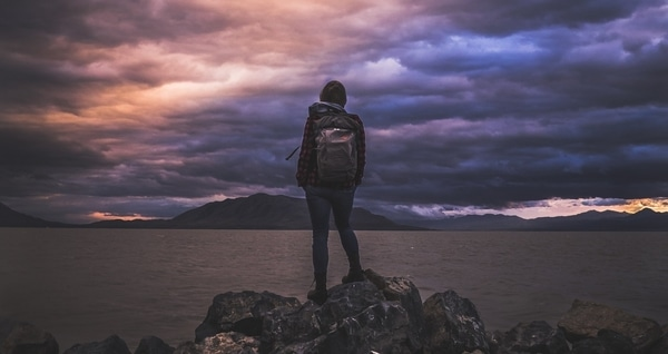 girl standing withhiking backpack