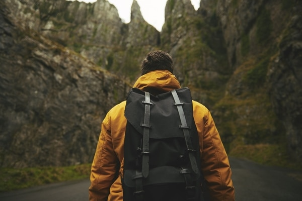 guy hiking with backpack