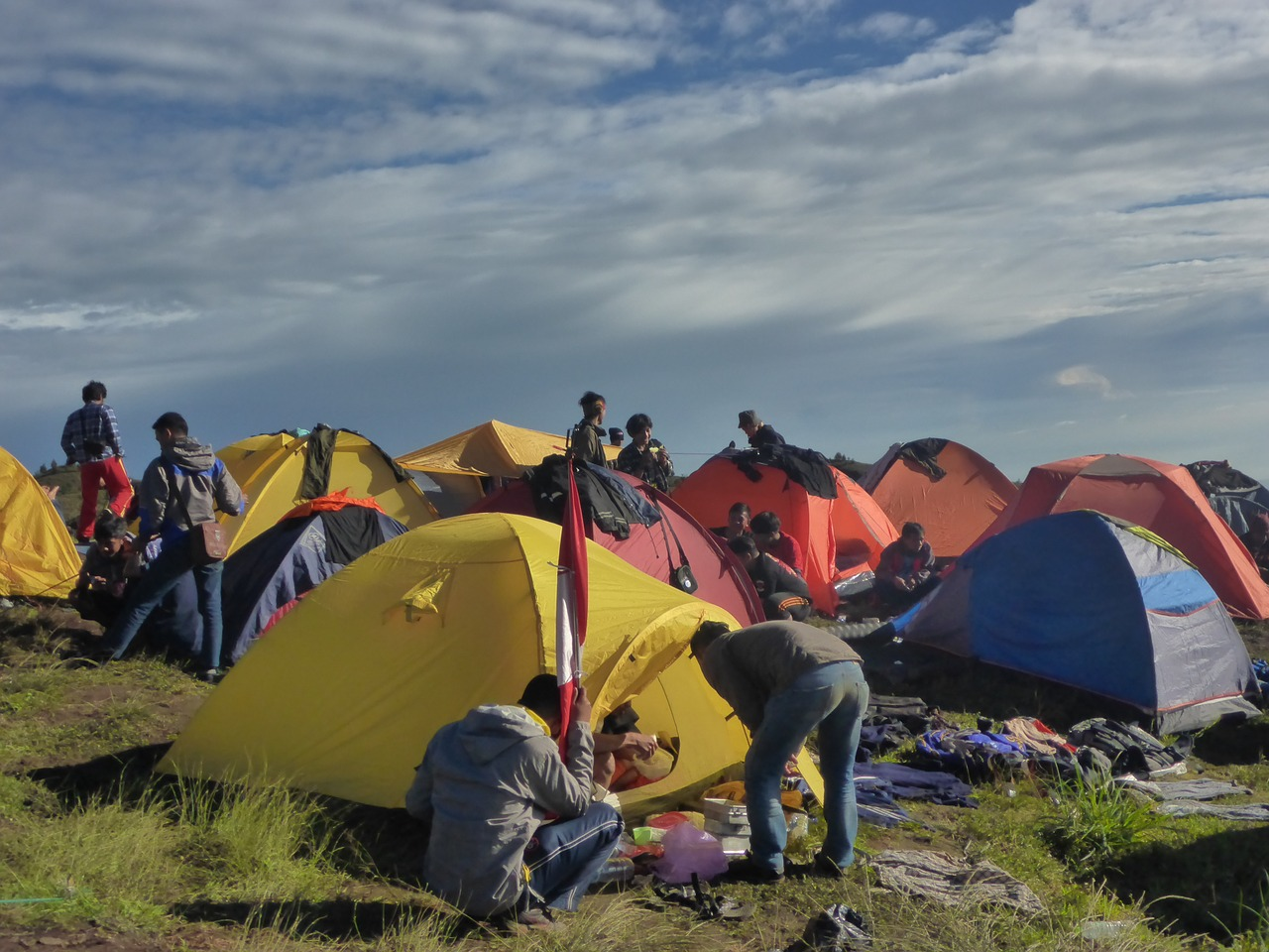 People setting up their camping gear