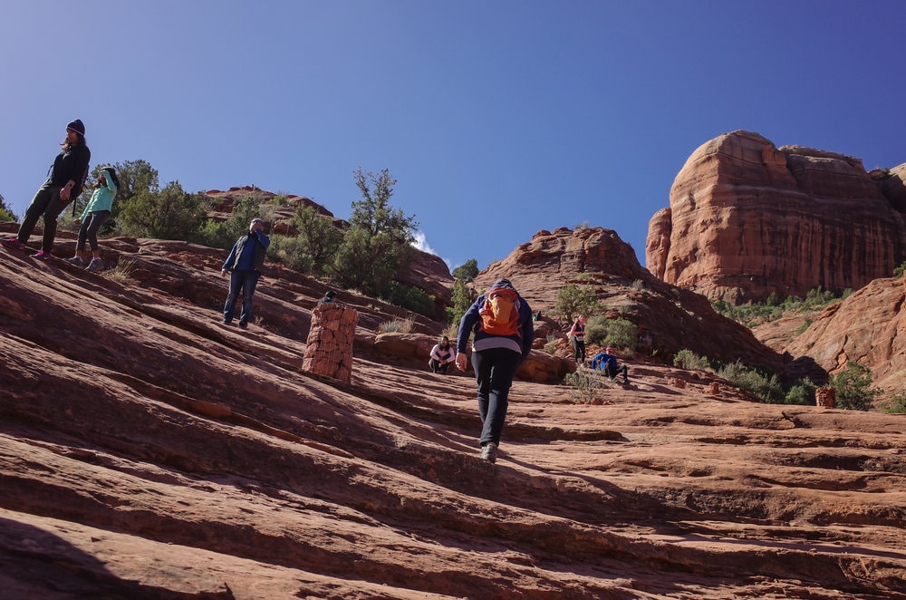 Group of people hiking on Cathedral Rock trail