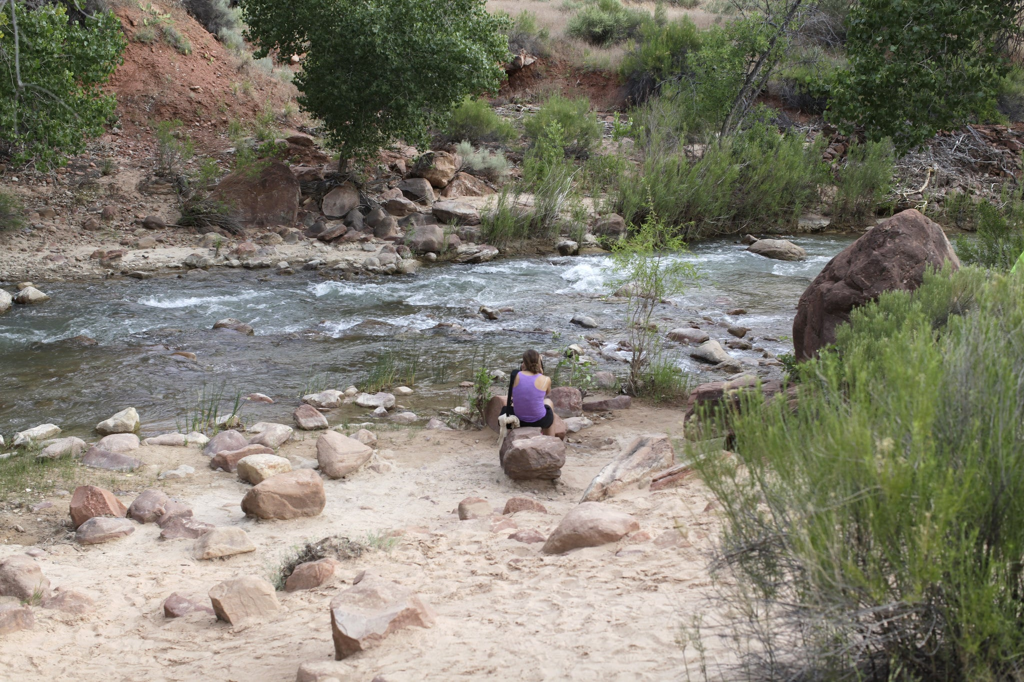 woman at the river  in zion national park