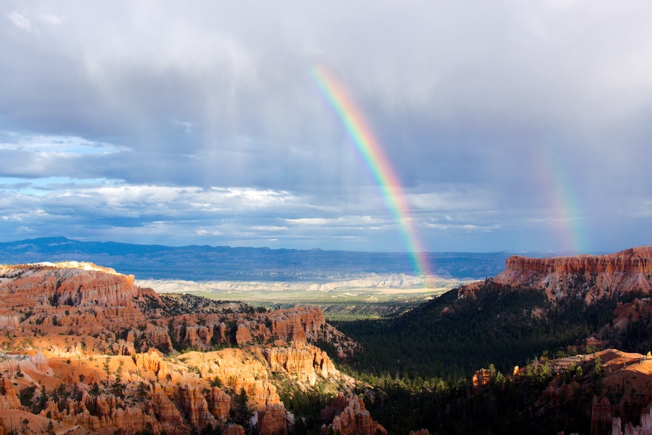cloudy sky with a rainbow at zion national park