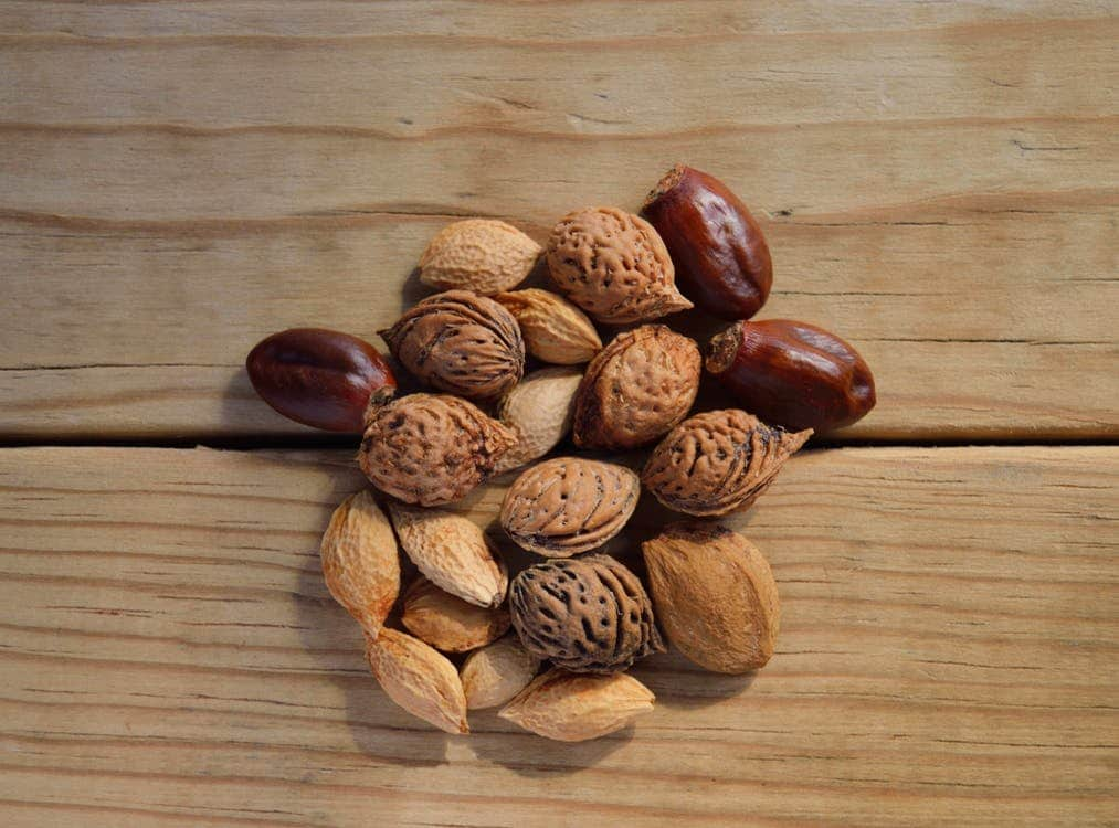 nuts and seed on top of a wooden surface