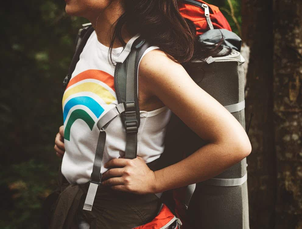 close up photo of woman wearing a backpack