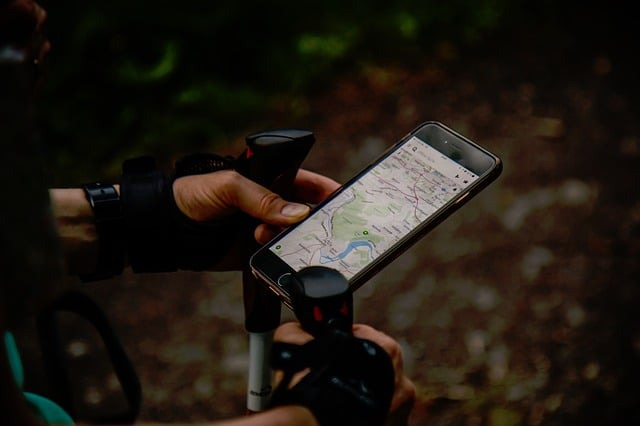 a hiker using gps, one of the things that backpacking beginners may find handy